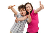 Boy and girl with thumbs up — Stock Photo