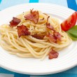 Pasta with bacon and vegetables — Stock Photo