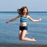 Teenage girl on beach — Stock Photo #32839859