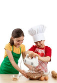 Kids mixing dough — Stock Photo