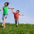 Girl and boy running outdoor — Stock Photo #32841681