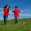 Girl and boy running  — Stock Photo