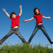 Girl and boy jumping  — ストック写真