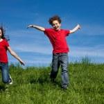 Girl and boy running — Stock Photo #32842899