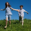 Girl and boy running outdoor — Foto de Stock