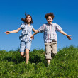 Girl and boy running outdoor — Stock Photo