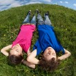 Kids relaxing on green meadow — Stock Photo