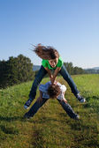 Girl and boy jumping, running outdoor — Stock Photo