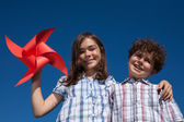 Young girl and boy outdoor — Stock Photo