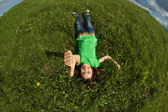 Girl relaxing on green meadow — Stock Photo