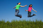 Girls jumping, running outdoor — Stock Photo