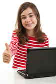 Young girl using laptop — Stock Photo