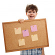 Young boy holding blank noticeboard — Stock Photo