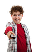 Boy holding remote control — Stock Photo