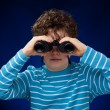 Boy looking through binocular — Stock Photo