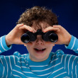 Boy looking through binocular — Stock Photo #32924975