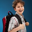 Student with backpack reading book — Stockfoto