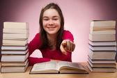 Student doing her homework — Stockfoto