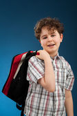 Student with backpack reading book — Foto Stock