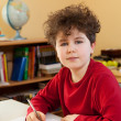 Boy learning at home — Stockfoto