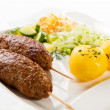 Roasted kebab with potatoes and vegetables — Stock Photo
