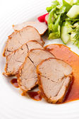 Roasted loin slices with vegetables — Stock Photo