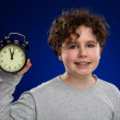 Young boy with alarm clock — Stock Photo