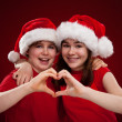 Boy and girl with Santa Claus Hats — Stock Photo #32994443