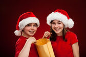 Boy and girl with Santa Claus Hats — Foto Stock