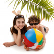 Kids lying under the palm — Stock Photo