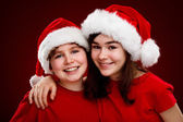 Boy and girl with Santa Claus Hats — Stock Photo