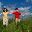 Girl and boy jumping, running — Stock Photo