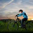Young boy riding bike — Stock Photo
