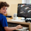 Boy using computer at home — Stock Photo