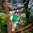 Stock Photo: Boy climbing in adventure park