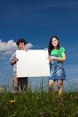 Kids holding noticeboard — Stock Photo