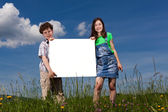 Kids holding noticeboard — Stock Photo