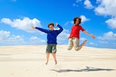 Kids jumping against blue sky — Stock Photo