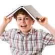 Boy with book on head — Stock Photo #33061967