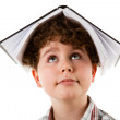 Stock Photo: Boy with book on head