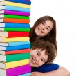 Kids behind pile of books — Stock Photo