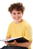 Livre de lecture garçon — Photo