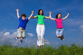 Family jumping, running outdoor — Stock Photo