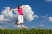 Woman jumping outdoor — Stock Photo