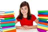 Student sitting near pile of books — Stock Photo