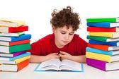 Student med högen av böcker — Stockfoto