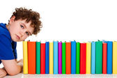 Student with pile of books — Stockfoto