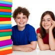 Students sitting behind pile of books — Stock Photo #33070561
