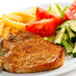 Grilled steak, French fries and vegetables — Photo