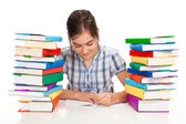 Student near the pile of books — Stock Photo